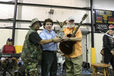 Mark Woods of Operation Troop Aid, Country music icon Marty Raybon, and the legendary Charlie Daniels with his 2010 Patriot Award at the Charlie Daniels Fan Club Party on June 9 in Nashville. PHOTO CREDIT: David Bellard
